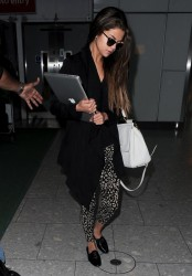 Selena Gomez - at Heathrow Airport in London 5/21/13